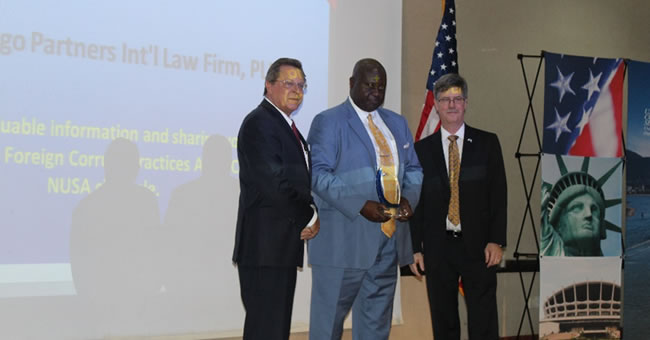 Photo: Herbert Igbanugo (center) receives his award and is flanked by U.S. Consul General F. John Bray and the U.S. Department of Commerce Deputy Assistant Secretary (DAS) for Middle East and Africa Seward Jones.
